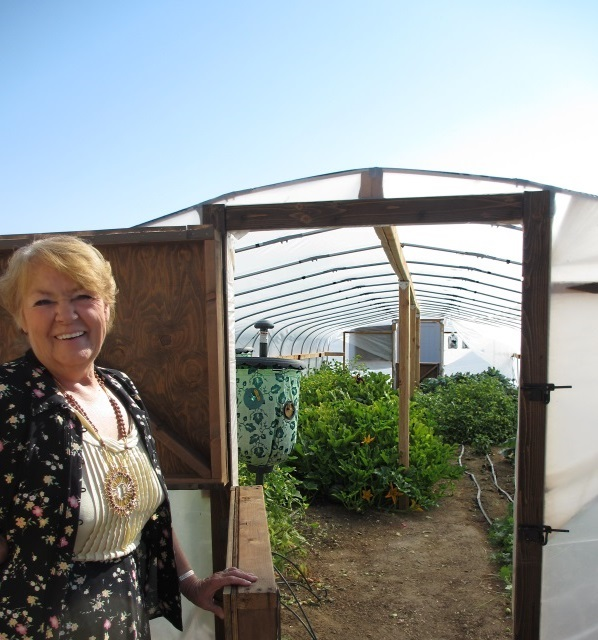 kathy-with-green-house