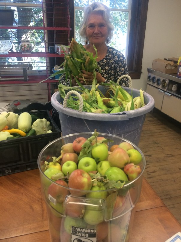 americorps-troyann-with-community-garden-veg