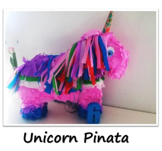 Unicorn Birthday Party with unicorn costume, birthday invitation, treats, unicorn cake, birthday games and birthday favors. #unicornparty #birthdayparty #birthdayfavors #unicorncake #pinata