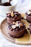 mini raw vegan chocolate cheesecakes with hazelnuts
