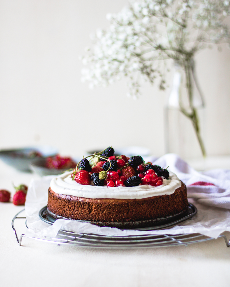 This is a recipe for gluten free cake made from chickpea flour, with cream cheese frosting and fresh fruits.