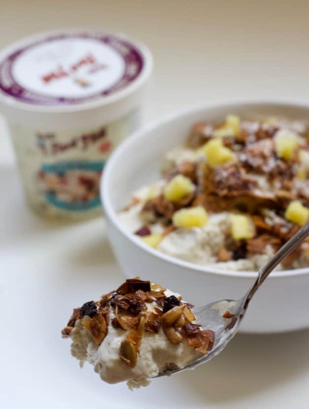 Vegan Pina Colada Ice Cream with Toasted Coconut Muesli | Healthy Helper Take a creamy, dreamy escape to the tropics with a bowl of this Vegan Pina Colada Ice Cream! Topped with toasted coconut muesli, this sweet, no-churn ice cream will be your new favorite warm weather treat. Gluten-free, refined sugar-free, and no ice cream maker required!