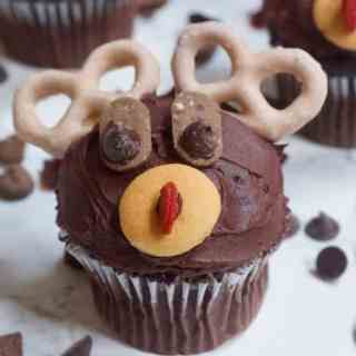 Rudolph the Red Nosed Reindeer Cupcakes | Healthy Helper Delicious vegan chocolate cupcakes decorated to the likeness of Rudolph, the Red Nosed Reindeer! The ULTIMATE holiday treat to make for your friends and family. Vegan, gluten-free, and naturally sweetened.