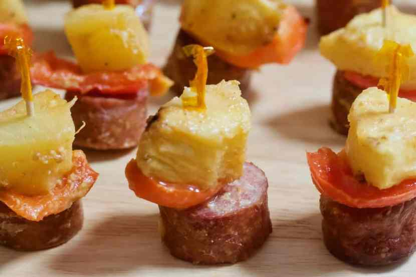 Sausage, Pepper, and Pineapple Skewers   Perfectly portioned, sweet and savory sausage kabobs paired with fresh red peppers and pineapple. Baked with a tangy Dijon-maple sauce, these mini-kabobs are a meaty mouthful that everyone will love to munch at your next get-together.