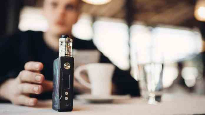 Using Electronic Cigarette To Smoke In Public Places.smoke Restr