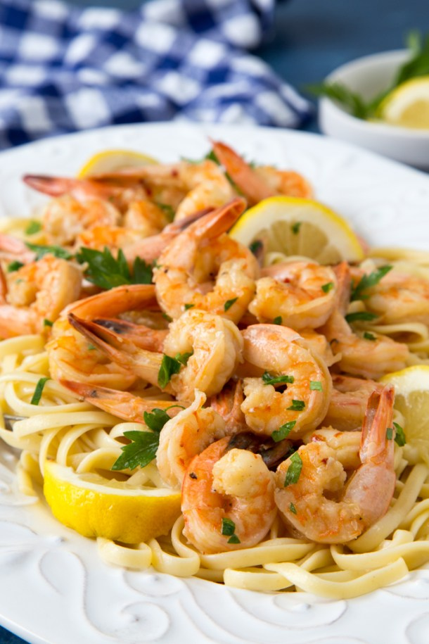 Healthy Shrimp Scampi - juicy cooked shrimp scampi over linguine on a white platter