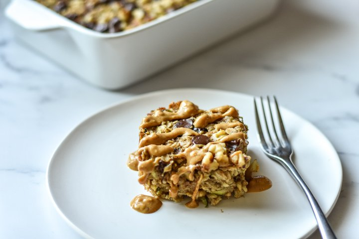 square of baked oatmeal on a small plate with fork