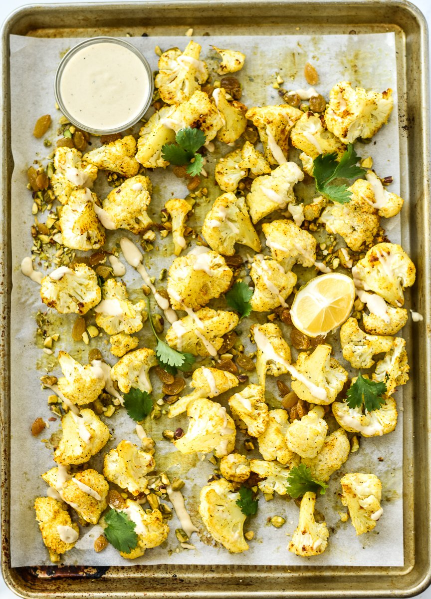 pan of roasted cauliflower with tahini drizzle