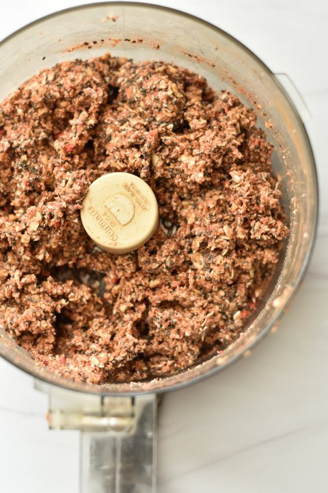 food processor with mixed oatmeal bite ingredients