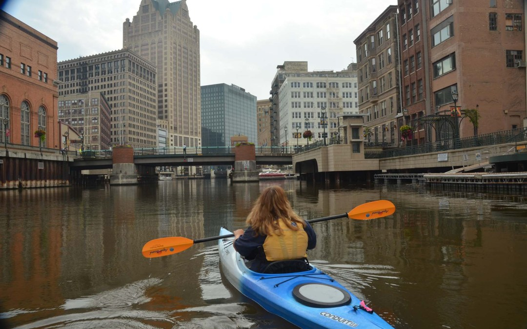 A woman kayaks down the Milwaukee River. Photo credit: John Karl Wisconsin Sea Grant.