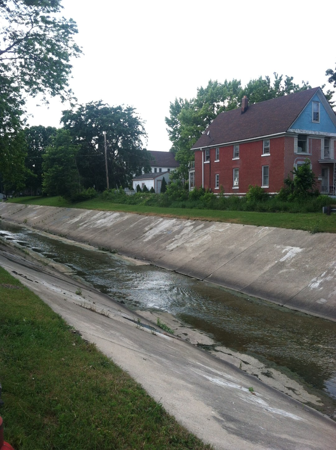 The Kinnickinnic before restoration had cement riverbanks and was treated like an open drain.