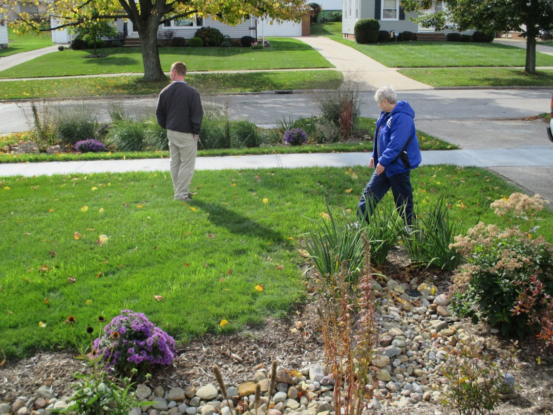 People admire a rain garden in Parma, Ohio.