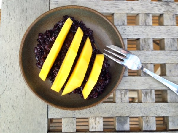 black coconut rice and mango porridge
