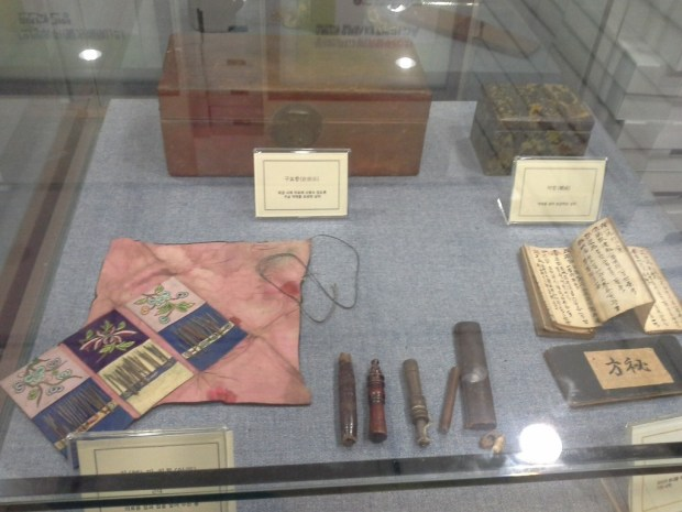 Ancient medical equipment, including acupuncture needles displayed in Korean Medicine Museum in KHU College of Korean Medicine.