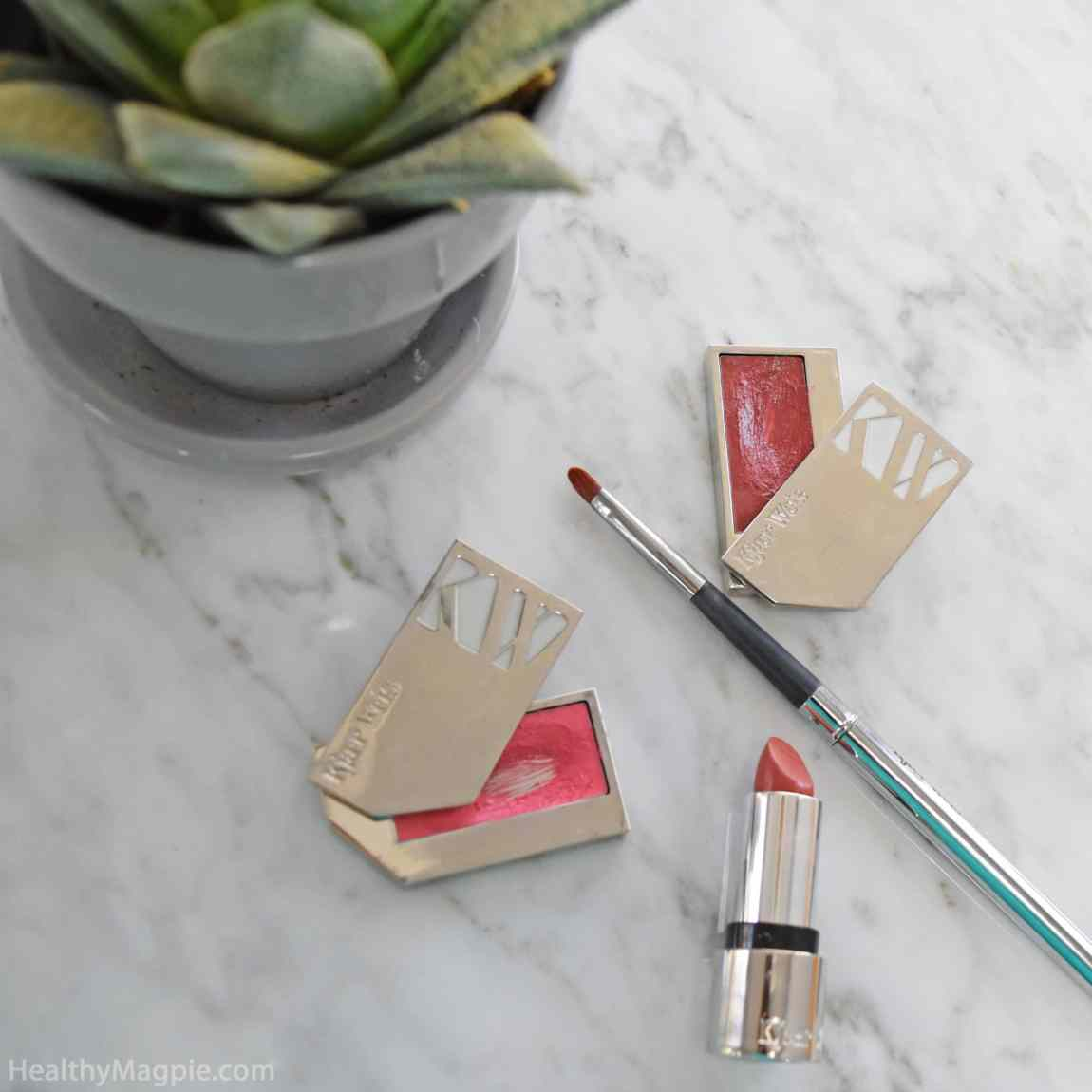 Picture, swatches and reviews of Kjaer Weis organic lipstick in Believe and Kjaer Weis organic lip tints. Most days I use my Kjaer Weis lip brush to apply a mix of both Sensuous Plum and Bliss Full lip tints.