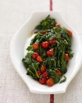 Wilted greens with tomatoes