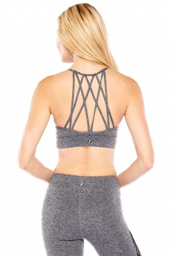 We LOVE this unique gym bra! Featuring a Heather Grey color, with a faux wrap design in front, and a strappy back design. One of a kind!