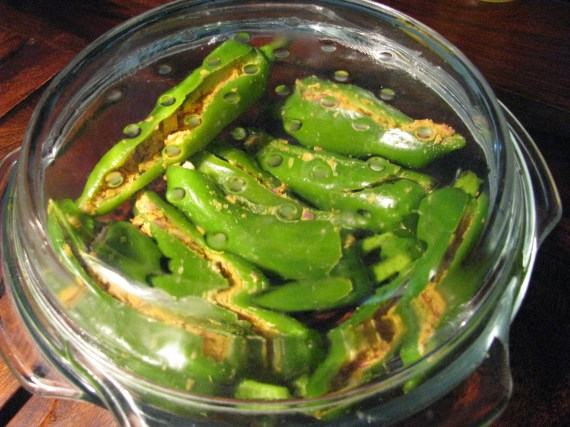stuffed marcha/mirchi/chilies/mirch in microwave safe bowl with its lid closed