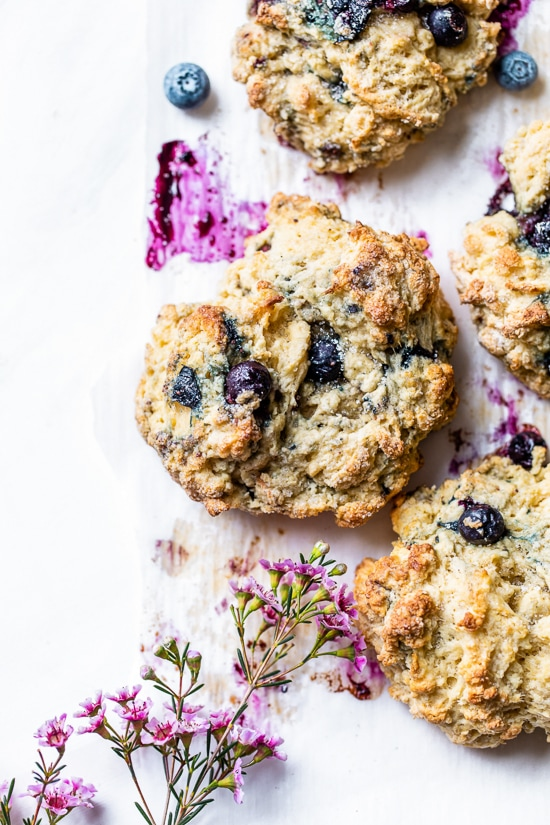 Lightened up, warm blueberry scones right out of the oven make the perfect Sunday morning breakfast along with a hot cup of tea.