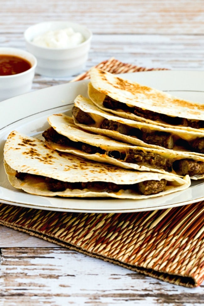 Sausage and Cheese Breakfast Quesadillas on plate with salsa and sour cream on the side