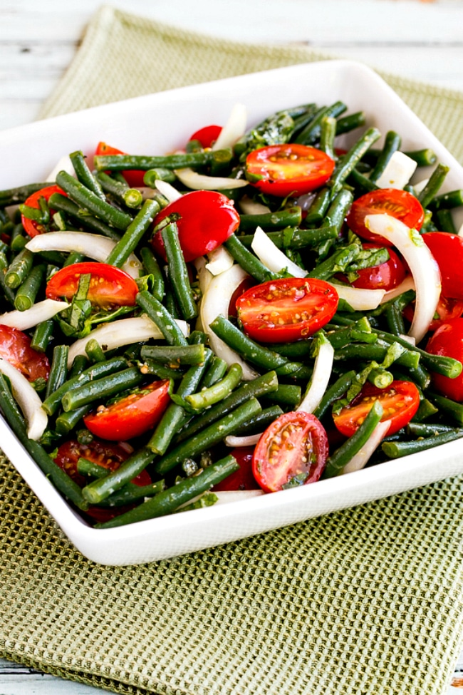 close-up photo of Green Bean and Tomato Salad in serving bowl