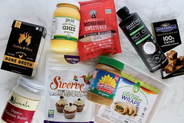 Packaged ingredients used to make crepes on white marble counter