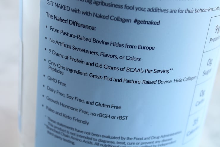 Close up of health benefits of naked collagen printed on blue tub