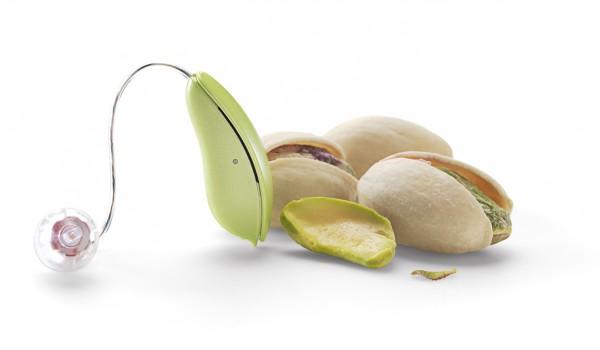 Oticon RITE hearing aids beside pistachio nuts to compare colour and size