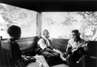Zora Neale Hurston, Rochelle French, and guitarist Gabriel Brown, Eatonville, Florida 1935; Alan Lomax, photographer
