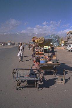 Kabul street with ruins