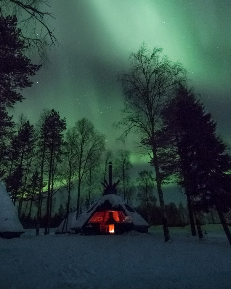 Northern Lights showing its magic on the frozen Olkkajärvi