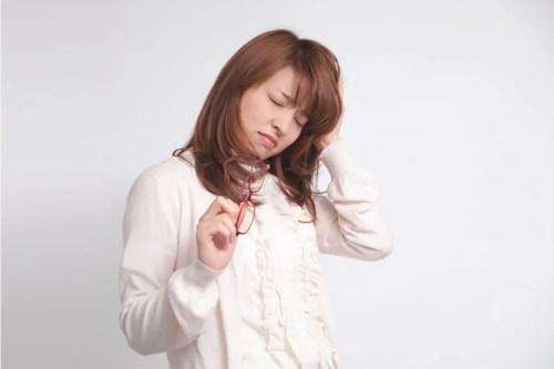 心身のストレスに悩む女性
