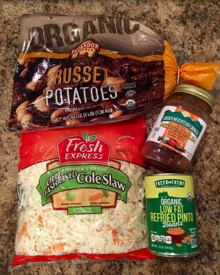 Bag of russet potatoes, bag of old fashioned Cole Slaw (shredded cabbage), jar of salsa, and can of low-fat refried pinto beans.