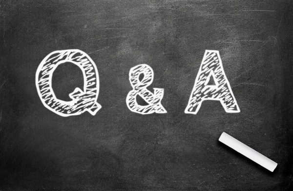 This image shows Q&A written in white chalk on a black chalkboard.