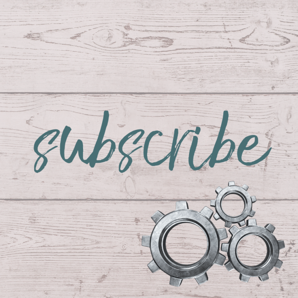 "This button reads ""subscribe"" and shows three interlocking gears against a light pink wood planked background."