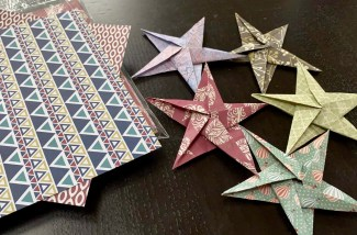 colorful origami paper and folded stars