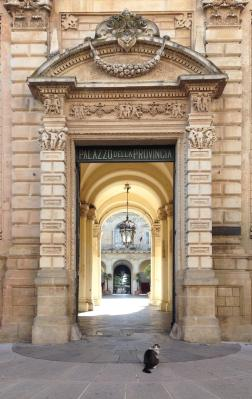 Provincial palazzo doorway leading to public gardens (DB).