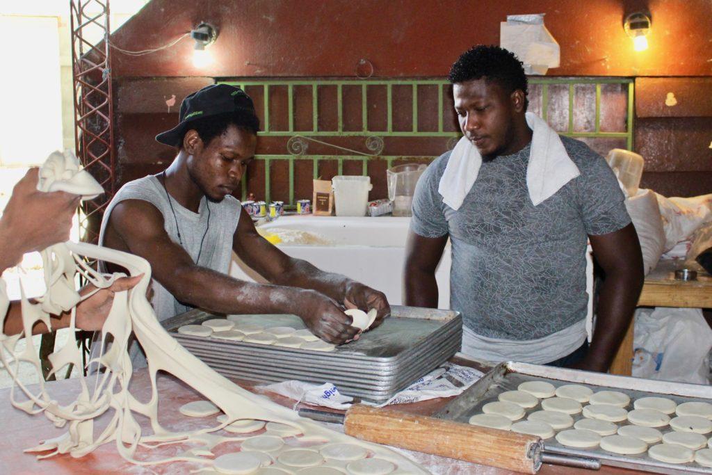 Employees prepare bread at Heartline Beltis Bakery Port au Prince Haiti