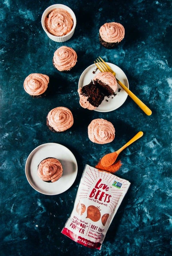 Vegan chocolate cupcakes are topped with an easy and pink vegan buttercream frosting, made with beets!