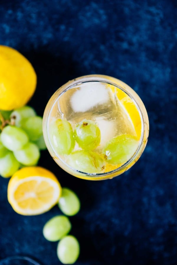Sweet Lemon Grape Sangria- An easy and breezy spring cocktail, made with sweet white wine and fresh grapes and lemon slices!