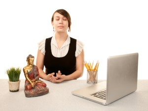 Woman meditating at her desk