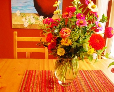 Flowers on table-painting in background