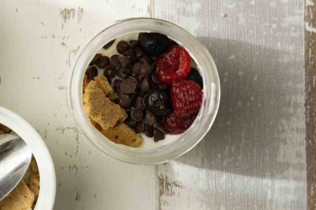 greek yogurt in jar with toppings