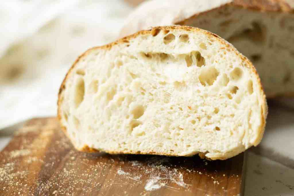 slice of sourdough bread on bread board