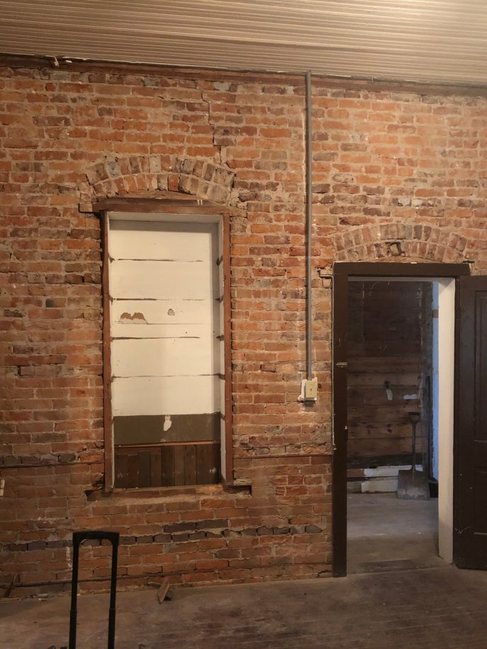 Here's the boarded-up window to the interior hallway. We'll open it up!