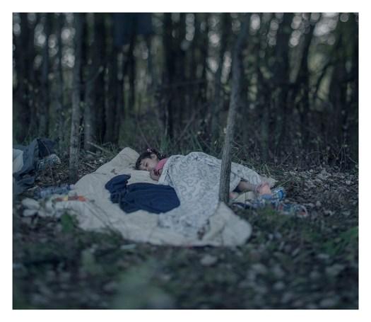 Refugee child sleeping MAGNUS WENNMAN