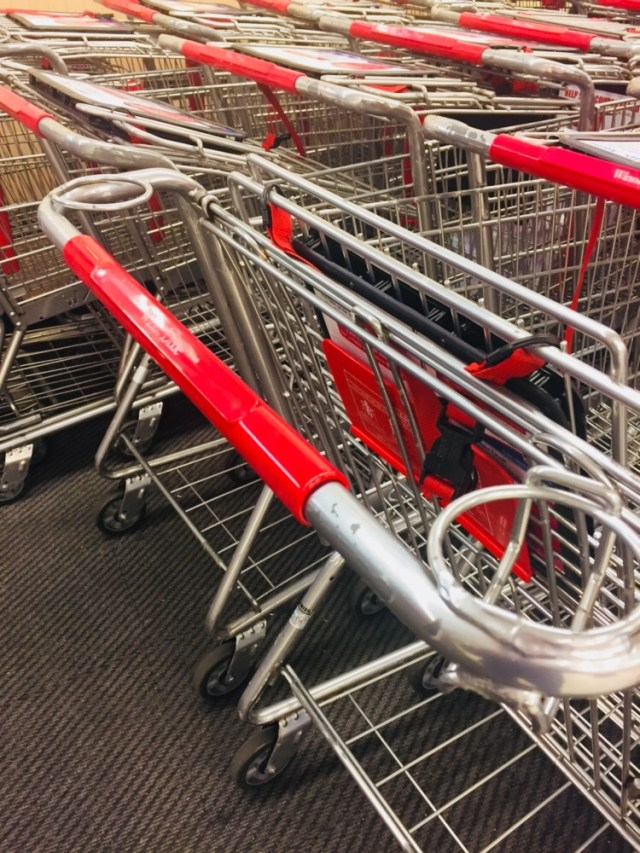 View of multiple grocery baskets with coffee holders