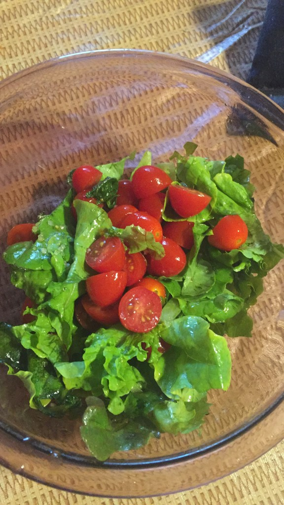 Cut garden lettuce with grape tomatoes