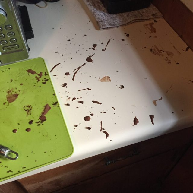 Chocolate splatters on kitchen counter
