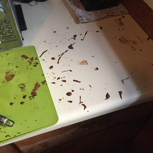 Chocolate splatters on kitchen counter